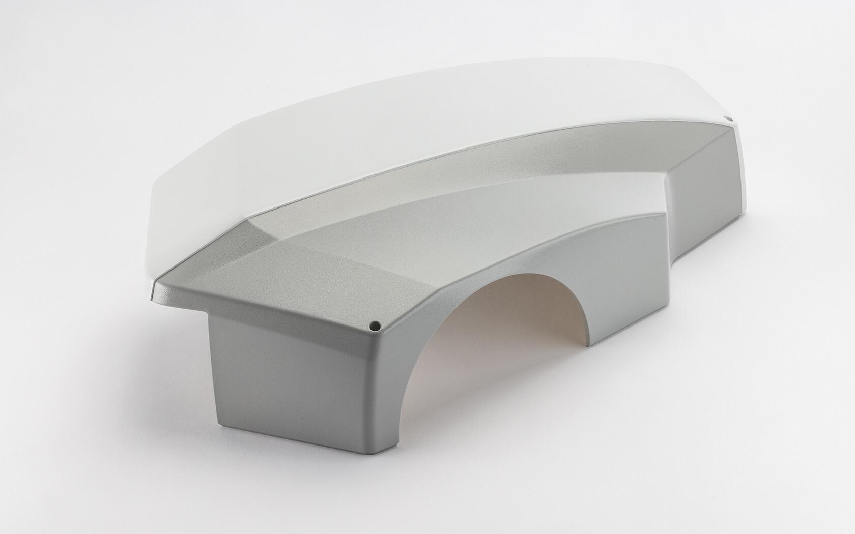 Referenzen Fried Kunststofftechnik GmbH: Kombination aus Strukturlackierung und sauberer Abklebearbeiten